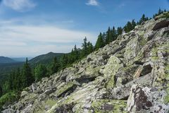 Natural landscape- alpine meadows Taganay. Natural landscape- mountain rocks, slopes of the Southern Urals. Alpine meadows in the national Park Taganay royalty free stock image