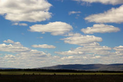 Natural landscape with blue sky, fluffy clouds and the Ural mountains stock photos