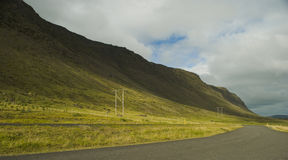 Natural landscape and electric cables. Beautiful natural park in Iceland and high tension lines and pylons Stock Photography
