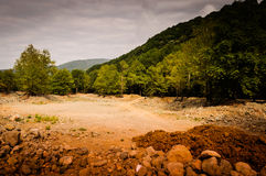 Natural Landscape With Golden Colors. Natural landscape located in Marmara region of the country Turkey with trees, rocks, stones and hills with golden colors Stock Image
