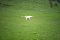 Natural landscape with green grass field under the sky with clouds and quadcopter. Yalta, Crimea-June 1, 2016: Natural landscape with green grass field under Royalty Free Stock Photo