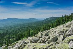 Natural landscape- alpine meadows Taganay. Natural landscape- mountain rocks, slopes of the Southern Urals. Alpine meadows in the national Park Taganay royalty free stock images