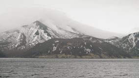 Natural landscape mountain with snowy peaks and sea water. View from cruise ship stock video footage
