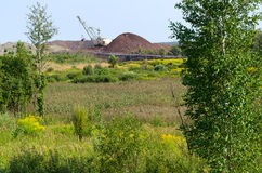 The natural landscape near dump and excavator Stock Photos