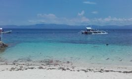 Translucent water Cebu island Philippines. Natural landscapes from Philippines Blue water with boat sunny natural day Cebu island Philippines royalty free stock photography