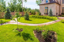 Natural landscaping in home garden Stock Photography