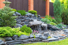Natural landscaping in home garden. Natural stone landscaping in home garden Stock Photo