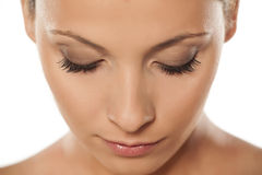 Natural lashes. Top view of a beautiful woman`s face with natural lashes Stock Photos