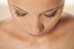 Natural lashes. Top view of a beautiful woman`s face with natural lashes Stock Image