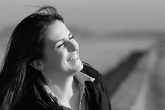 Natural laughing. Beautiful happy young woman laughing natural black/white Stock Images