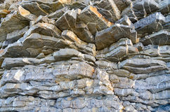 Natural layered structure of the stone rock Royalty Free Stock Photos