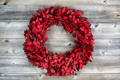 Natural leaf wreath for the seasonal holidays on rustic wood Royalty Free Stock Photo