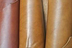 Natural leather fabric rolls. Closeup of various colors natural cow leather fabric rolls stock photos