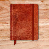 Natural Leather Notebook On A Wooden Desk. Copybook With Band Royalty Free Stock Photo
