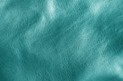 Natural leather on sun in cyan tone. Abstract background and texture for design stock photo