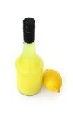 Natural Lemon Juice. Natural Organic Lemon Juice and a lemon isolated on white background Stock Images