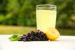 Natural Lemonade with elder berries Royalty Free Stock Photography