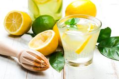 Homemade lemonade with reamer on white wooden table Royalty Free Stock Images