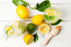 Homemade lemonade with reamer on white wooden table Stock Photography