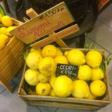 Lemons for sale. Natural lemons in a wooden box offered for sale in Italy Stock Photo