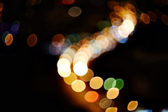 Natural lens blurred color bokeh on dark nightlife of city background Royalty Free Stock Photography
