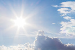 The natural lens flare and radiating rays in a blue sky with clouds Royalty Free Stock Photos