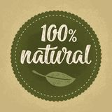 100 natural lettering with leaf. Vector dark green vintage illustration. 100 natural lettering with leaf. Vector beige vintage illustration isolated on dark Royalty Free Stock Image