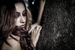 Natural life, beautiful woman hugging a tree Royalty Free Stock Photo