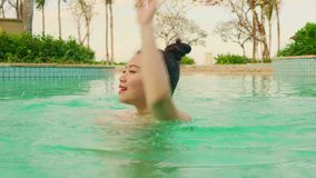 Natural lifestyle shot on young happy and beautiful Asian Korean woman in bikini enjoying Summer holiday getaway at luxury hotel. Natural lifestyle shot on young stock video footage