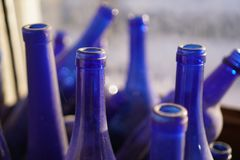 Blue bottles in window royalty free stock photos