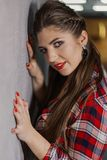 Natural light indoor portrait of young pretty girl with long dark brown hair, natural makeup and red lips. Stylish woman. Looking at you royalty free stock photos
