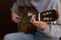 Male performer guitar player stock photo