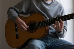 Male performer guitar player, hand focus royalty free stock photography