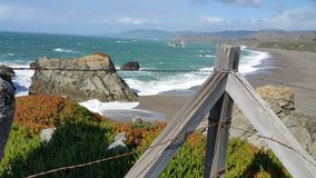 Natural Light-Overlook ocean- barbed wire and posts. A dangerous overlook by Bodega Bay area is fenced off with barbed wire and posts.  Regardless the views if Royalty Free Stock Photography