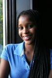 Natural light portrait of smiling black teen Stock Images
