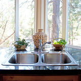 Natural Lighting Stainless Kitchen Window and Sink Stock Images