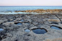 Limestone beach in malta at sunset Royalty Free Stock Images