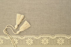Natural linen background with lace. Natural linen uncolored background with lace and brushes Royalty Free Stock Images