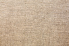 Natural linen fabric. Background of natural linen fabric. Sack texture Stock Images