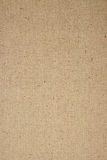 Natural Linen Fabric Background. Natural Tan Linen Fabric Textured Background in a Vertical Orientation Stock Photography