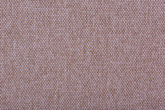 Natural linen fabric for embroidery. Beige, brown color. Natural linen fabric for embroidery. Beige, brown color Royalty Free Stock Images