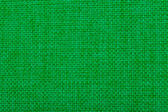 Natural linen fabric for embroidery. Green color. Stock Photos