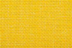 Natural linen fabric for embroidery. Yellow color. Natural linen fabric for embroidery. Yellow color Stock Image