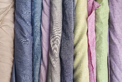 Natural linen fabric in roll background Royalty Free Stock Image