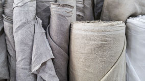 Natural linen fabric in roll. For design work Stock Photography
