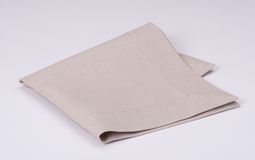 Natural Linen Napkin On White Background.  Royalty Free Stock Image