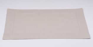 Natural Linen Napkin On White Background.  Royalty Free Stock Images