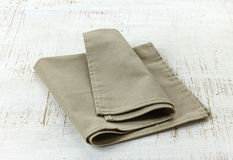 Natural linen napkin. On white wooden table royalty free stock images