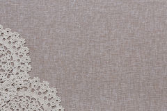 Natural linen texture with white lace. Natural linen texture with beige lace on the left bottom corner. Empty copyspace Royalty Free Stock Photography