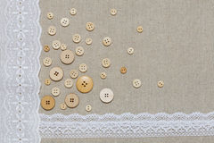 Natural linen texture with white lace and buttons Stock Image